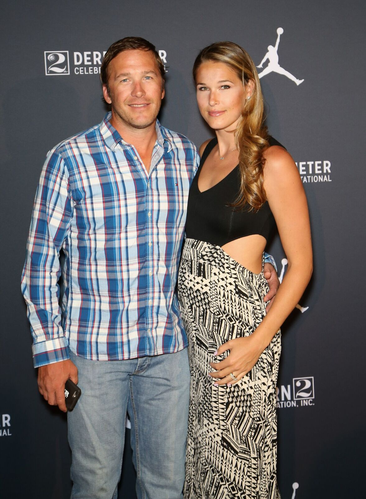 Olympic skier and World Cup alpine ski racer Bode Miller (L) and his wife, professional beach volleyball player/model Morgan Beck, arrive at the Liquid Pool Lounge for the kickoff of Derek Jeter's Celebrity Invitational at the Aria Resort & Casino on April 20, 2016 in Las Vegas, Nevada | Photo: Getty Images