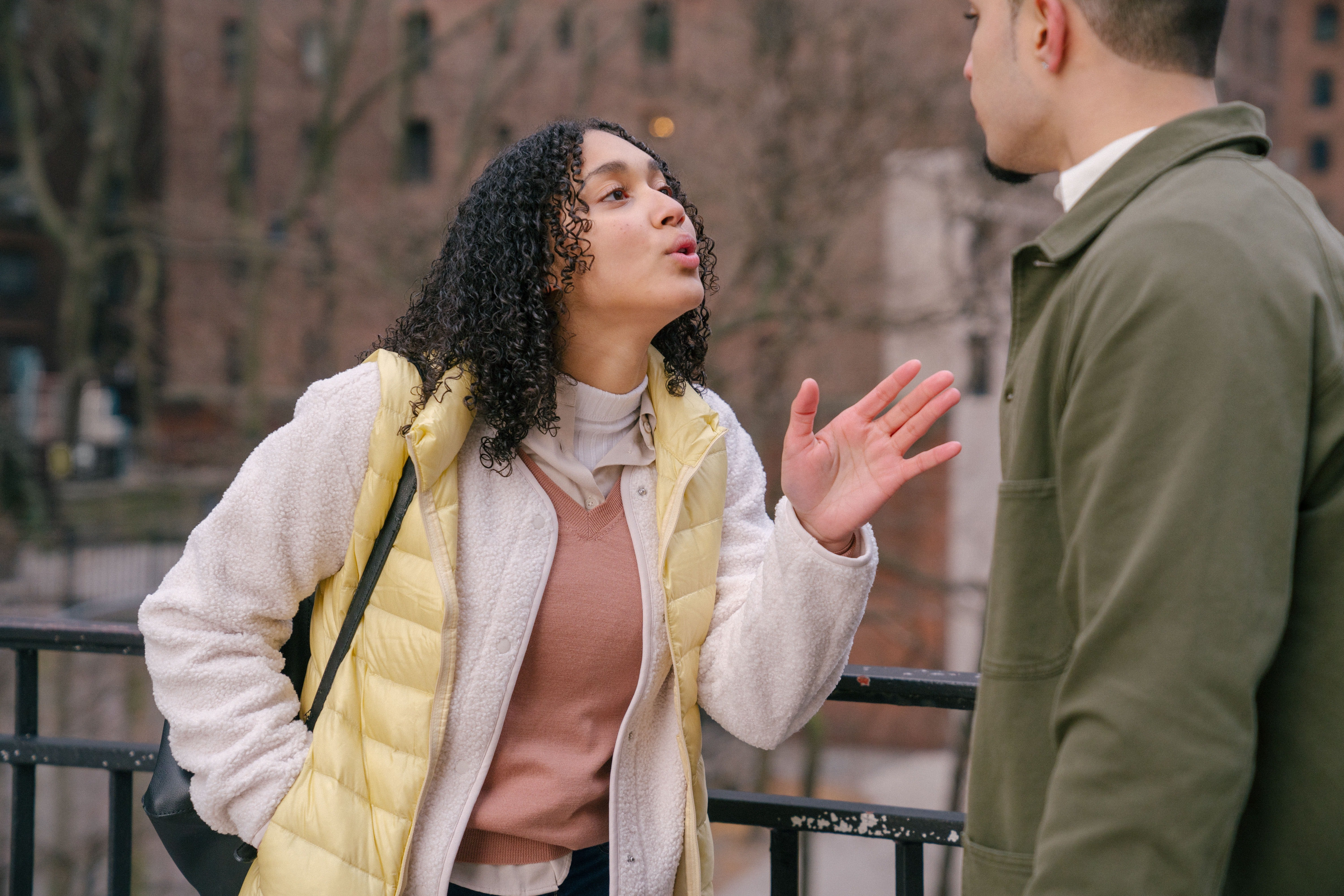 Woman asking a man to back off   Photo: Pexels