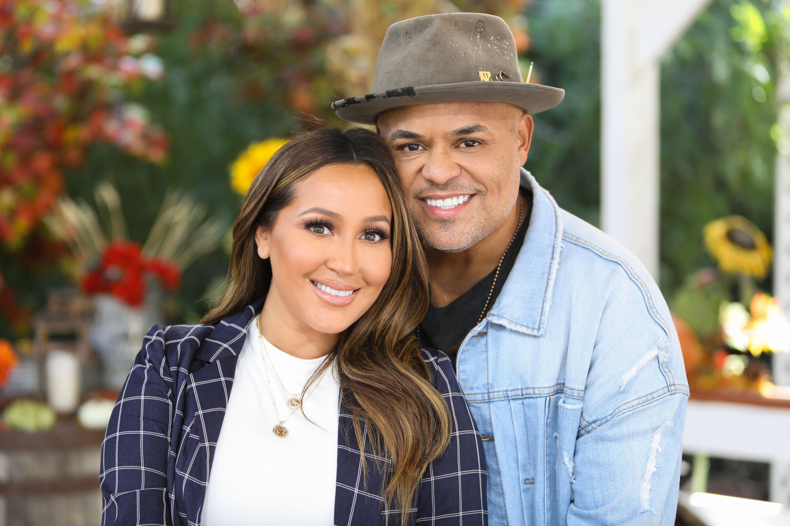 A portrait of Adrienne Bailon and Israel Houghton outdoors | Source: Getty Images/GlobalImagesUkraine