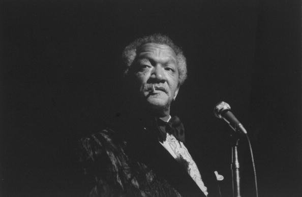 Comedian Redd Foxx performing on stage | Photo: Getty Images