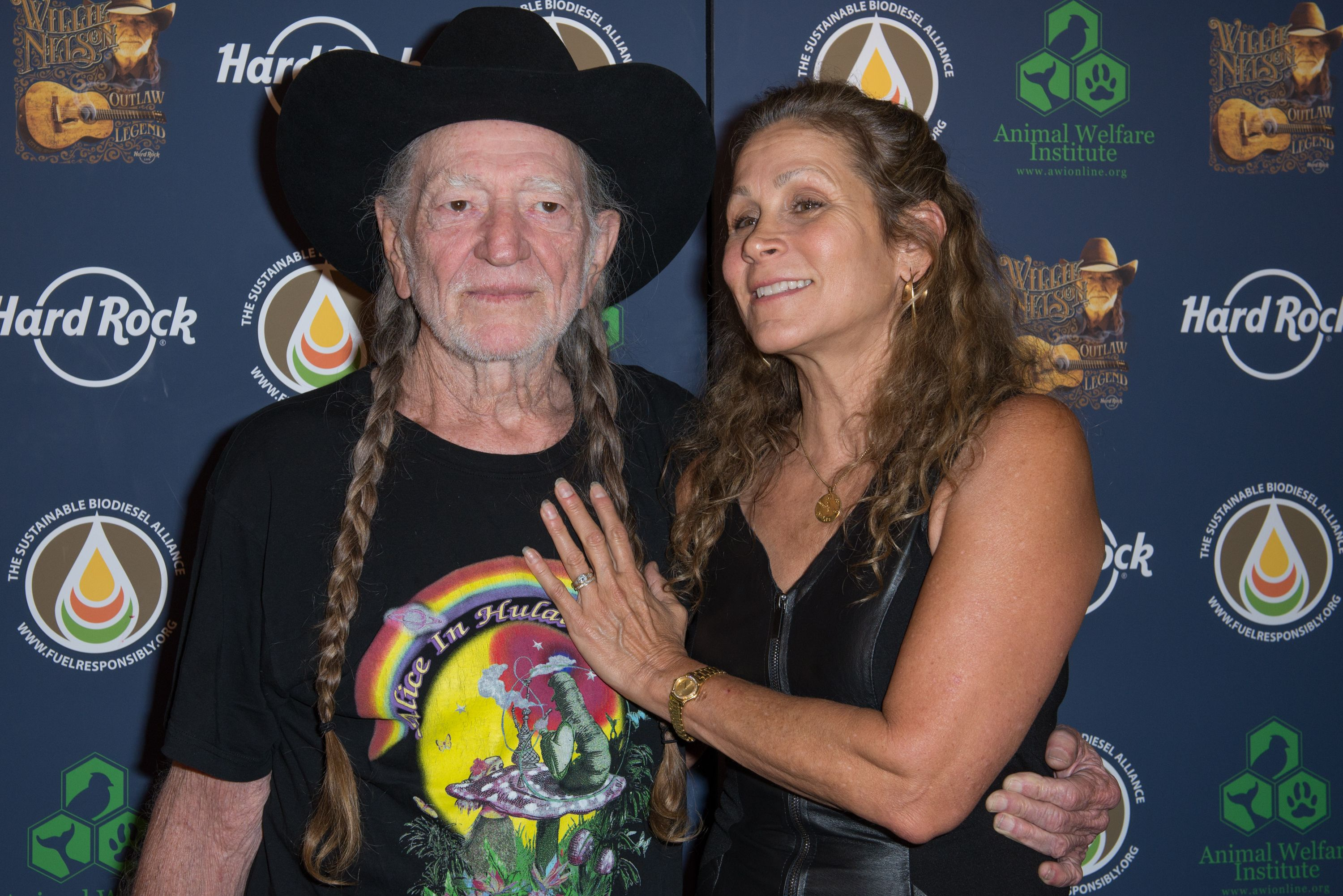 Willie Nelson with wife Annie D'Angelo at Hard Rock International's Wille Nelson Artist Spotlight Benefit Concert at Hard Rock Cafe in New York City, New York | Photo: Mike Pont/Getty Images