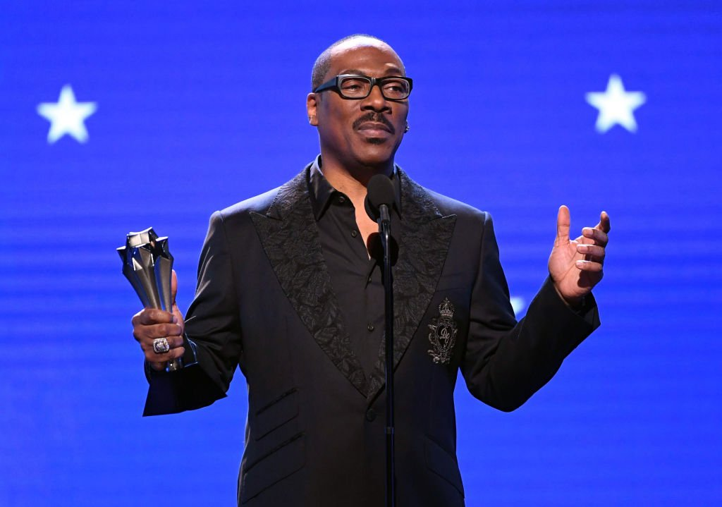 Eddie Murphy accepts the Lifetime Achievement Award at the 25th Annual Critics' Choice Awards at Barker Hangar on January 12, 2020   Photo: Getty Images