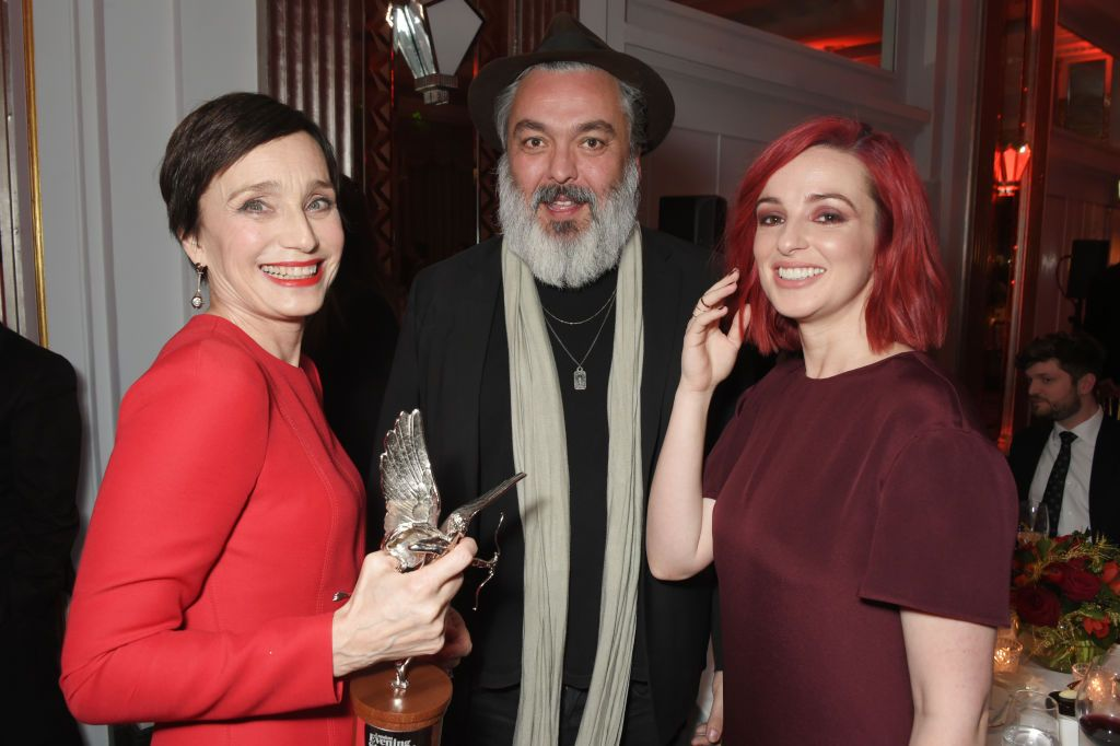 Jez Butterworth and Laura Donnelly with Dame Kristin Scott Thomas at the London Evening Standard British Film Awards in 2018 in London, England | Source: Getty Images
