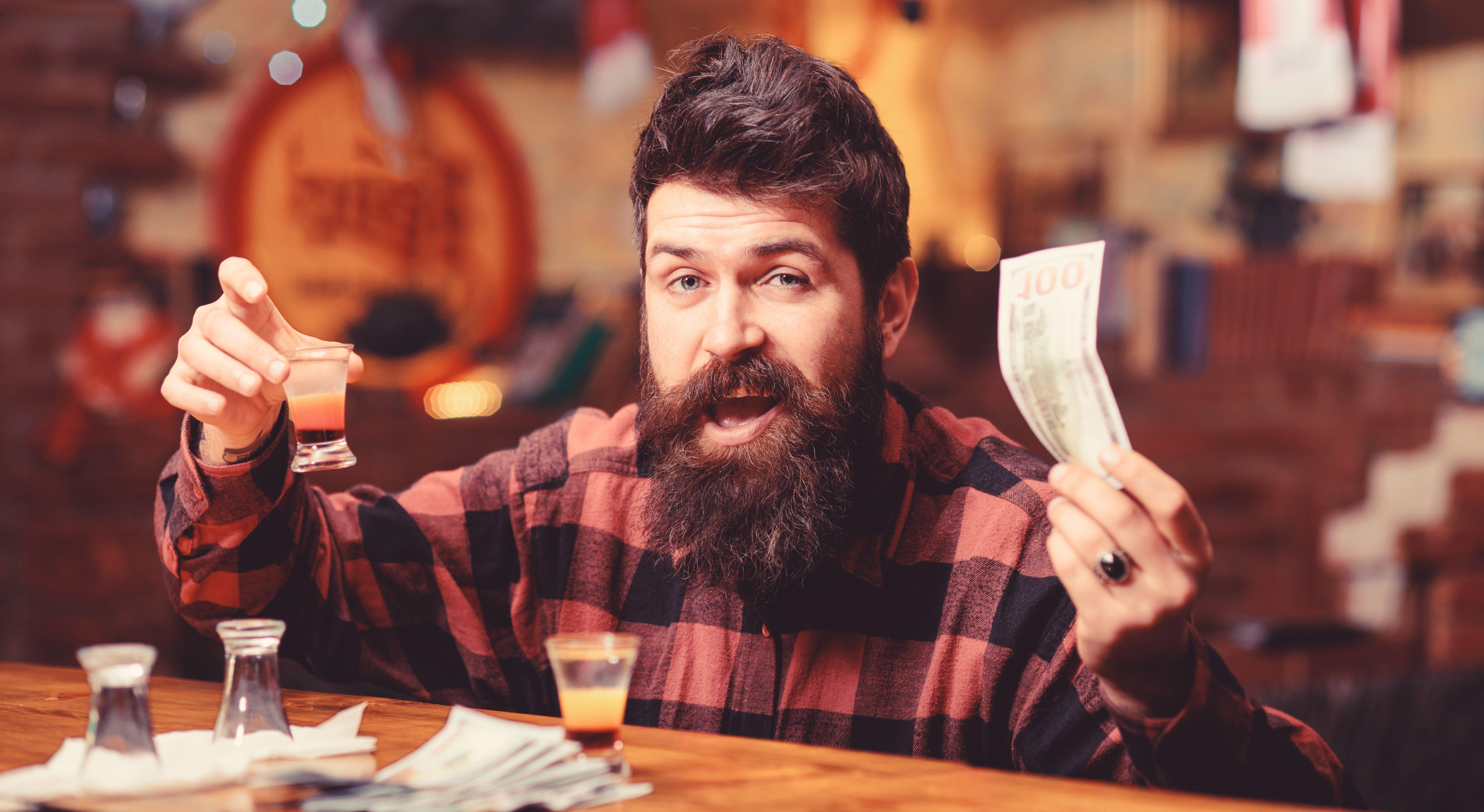 Drunk man at bar. Image credit: Pixabay