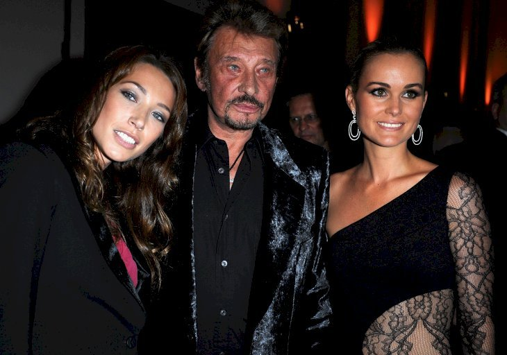 Johnny Hallyday accompagné de Laeticia hallyday et laura Smet | Photo : Getty Images