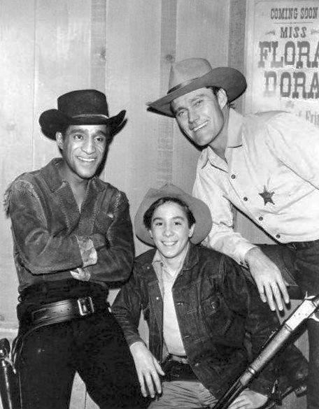 "Publicity photo from the television program ""The Rifleman"" with Sammy Davis, Jr., Johnny Crawford, and Chuck Connors in 1962. 