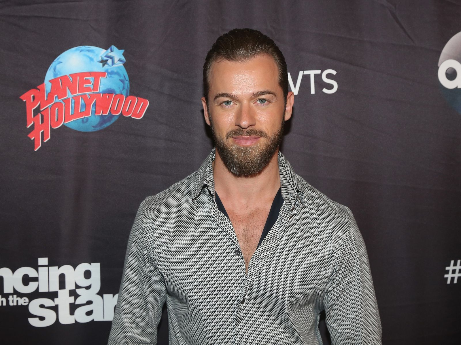 """Artem Chigvintsev poses as the """"Dancing with the Stars: Athletes Season 26"""" cast visits Planet Hollywood Times Square on April 13, 2018, in New York City 