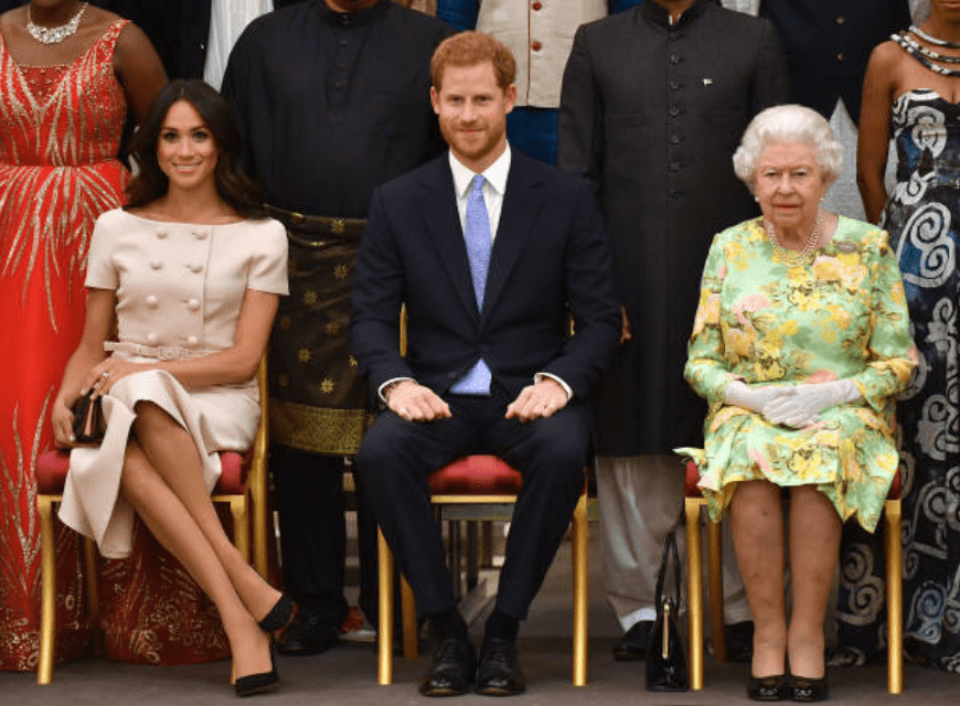 Meghan Markle, Prince Harry, and Queen Elizabeth pose for a group picture at the Queen's Young Leaders Awards Ceremony at Buckingham Palace on June 26, 2018, in London, England. Source: John Stillwell - WPA Pool/Getty Images
