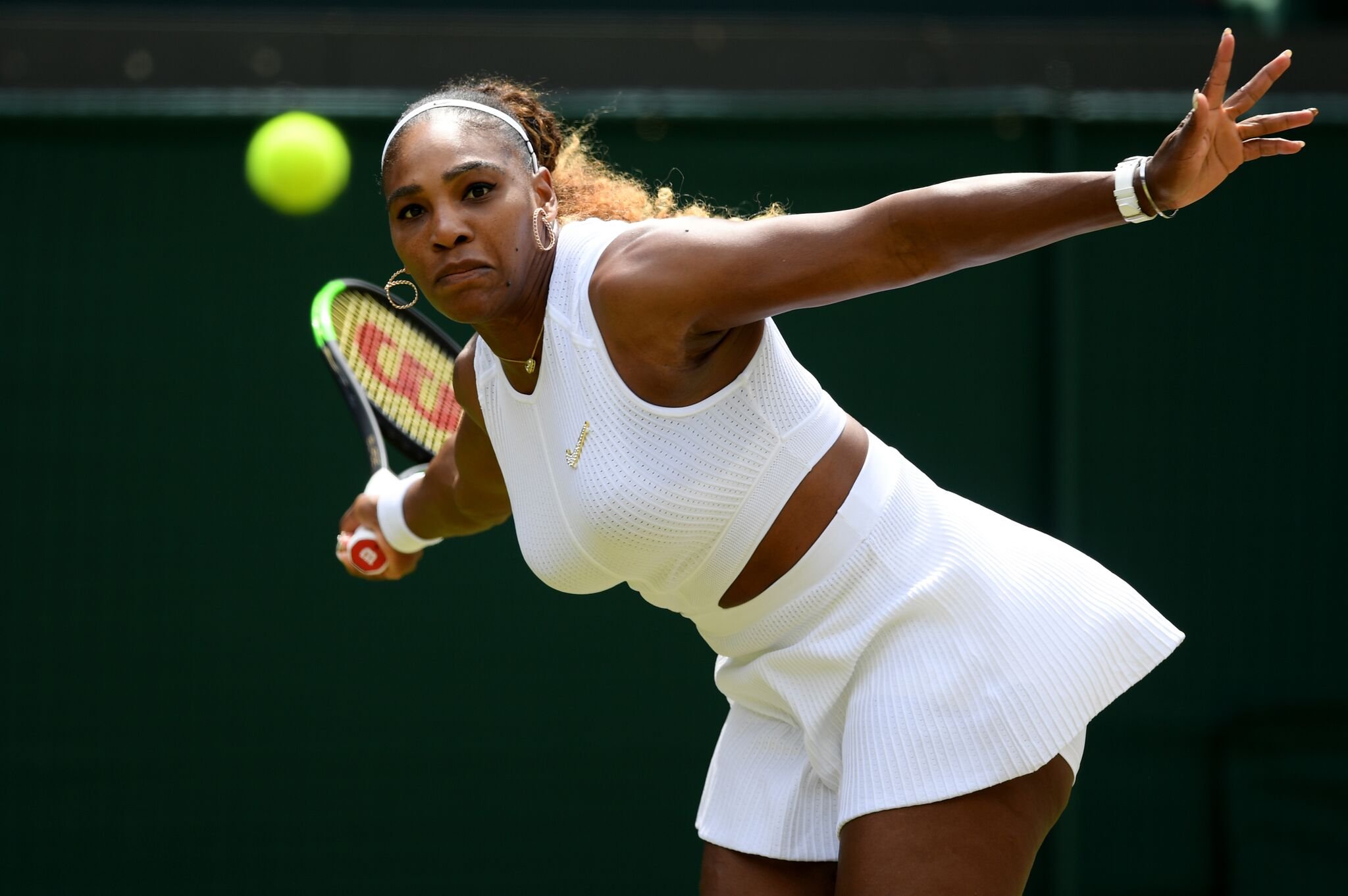 Serena Williams of the United States plays a forehand in her Ladies' Singles fourth round match against Carla Suarez Navarro of Spain during Day Seven of The Championships  | Getty Images