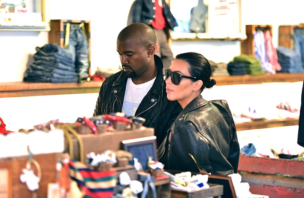 Kanye West and Kim Kardashian visit children's clothing store Trico Field on June 1, 2015. | Photo: Getty Images