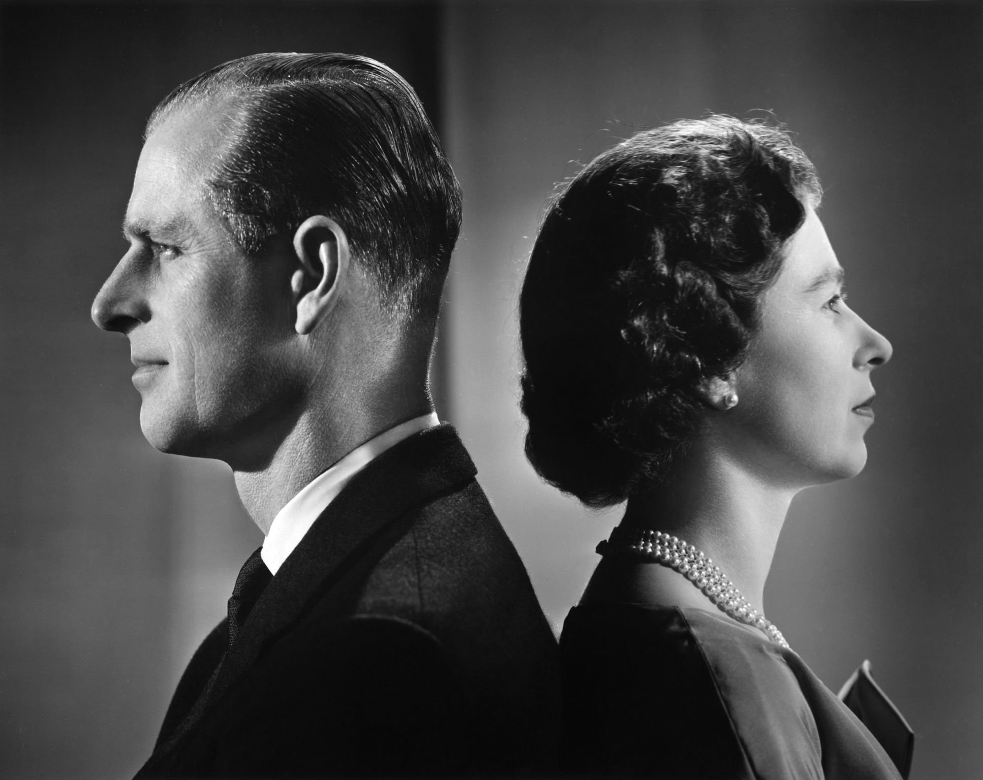 Queen Elizabeth II and Prince Philip pose for a portrait at home in Buckingham Palace in 1958 in London, England   Source: Getty Images