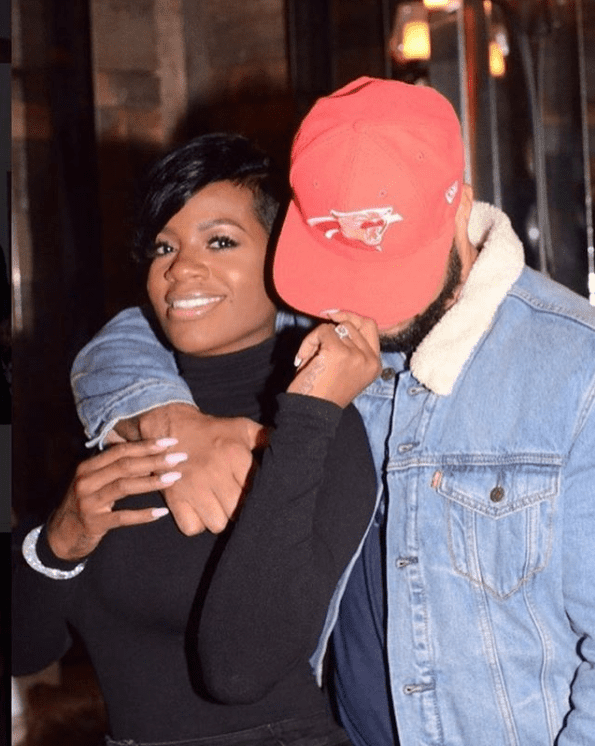 Power couple Fantasia Barrino and Kendall Taylor displaying sweet affection for each other. | Photo: instagram.com/tasiasword