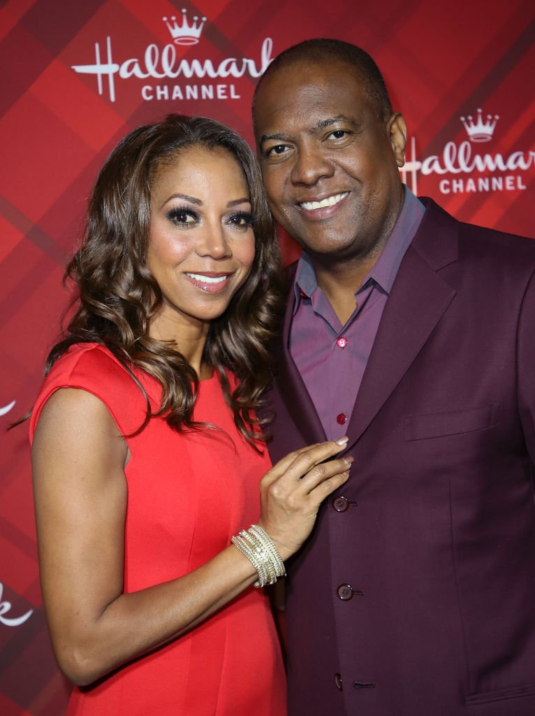 "Holly Robinson Peete (L) and husband Rodney Peete attend a screening of Hallmark Channel's ""Christmas at Holly Lodge"" at The Grove on December 4, 2017 