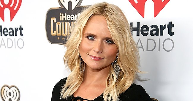 Miranda Lambert Looks Confident Sitting behind the Wheel of a Gorgeous Vintage Red Truck