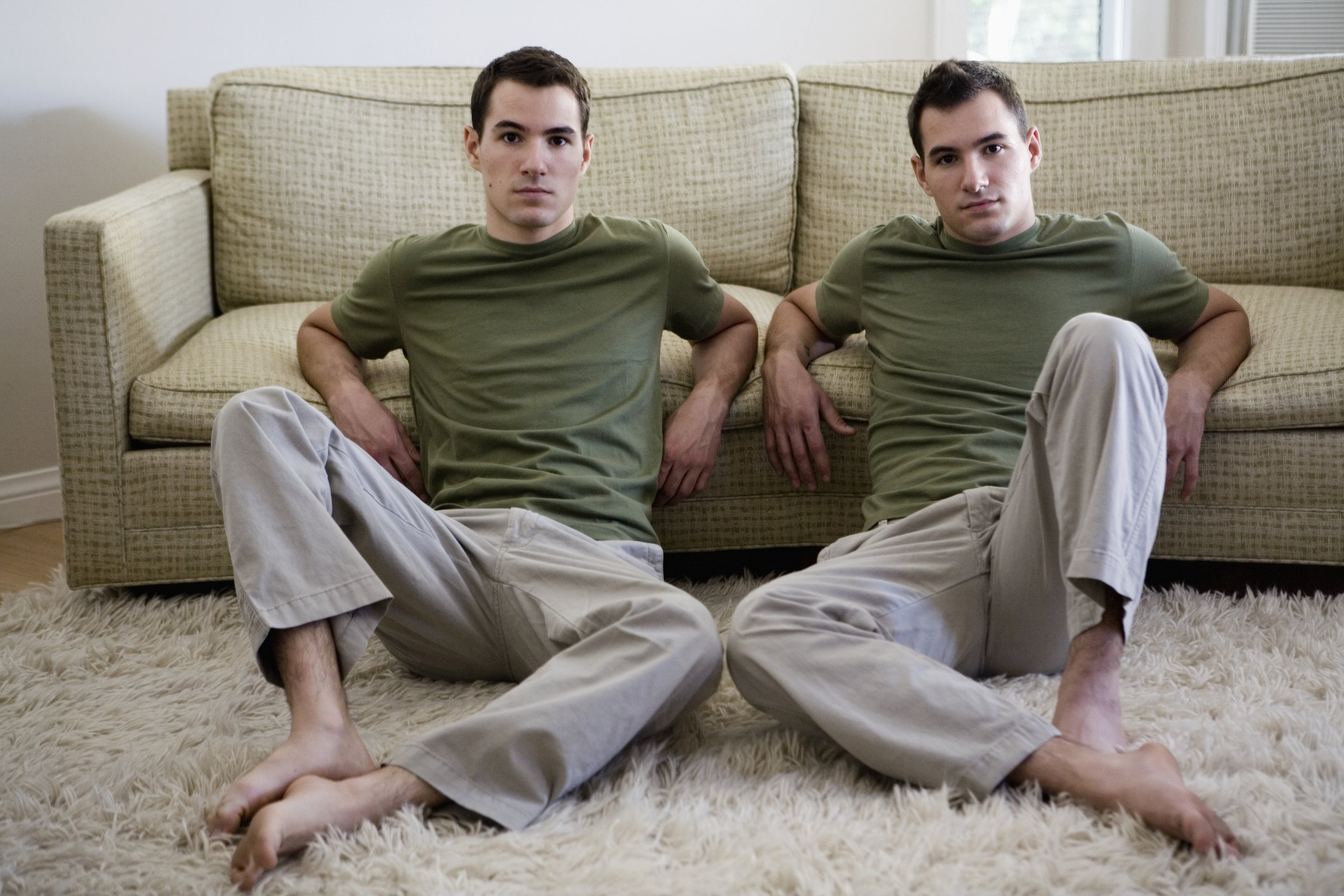 A portrait of twin brothers sitting in the living room.   Photo: Getty Images