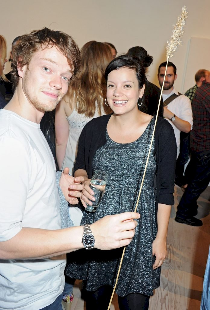 LONDON, ENGLAND - JULY 28: (EMBARGOED FOR PUBLICATION IN UK TABLOID NEWSPAPERS UNTIL 48 HOURS AFTER CREATE DATE AND TIME. MANDATORY CREDIT PHOTO BY DAVE M. BENETT/GETTY IMAGES REQUIRED) Lily Allen (R) and brother Alfie Allen attend a private view of works by five leading artists who have created pieces inspired by Reebok's Zig Tech technology hosted by Reebok and style magazine Wallpaper* at The Great Room on July 28, 2011 in London, England. (Photo by Dave M. Benett/Getty Images)