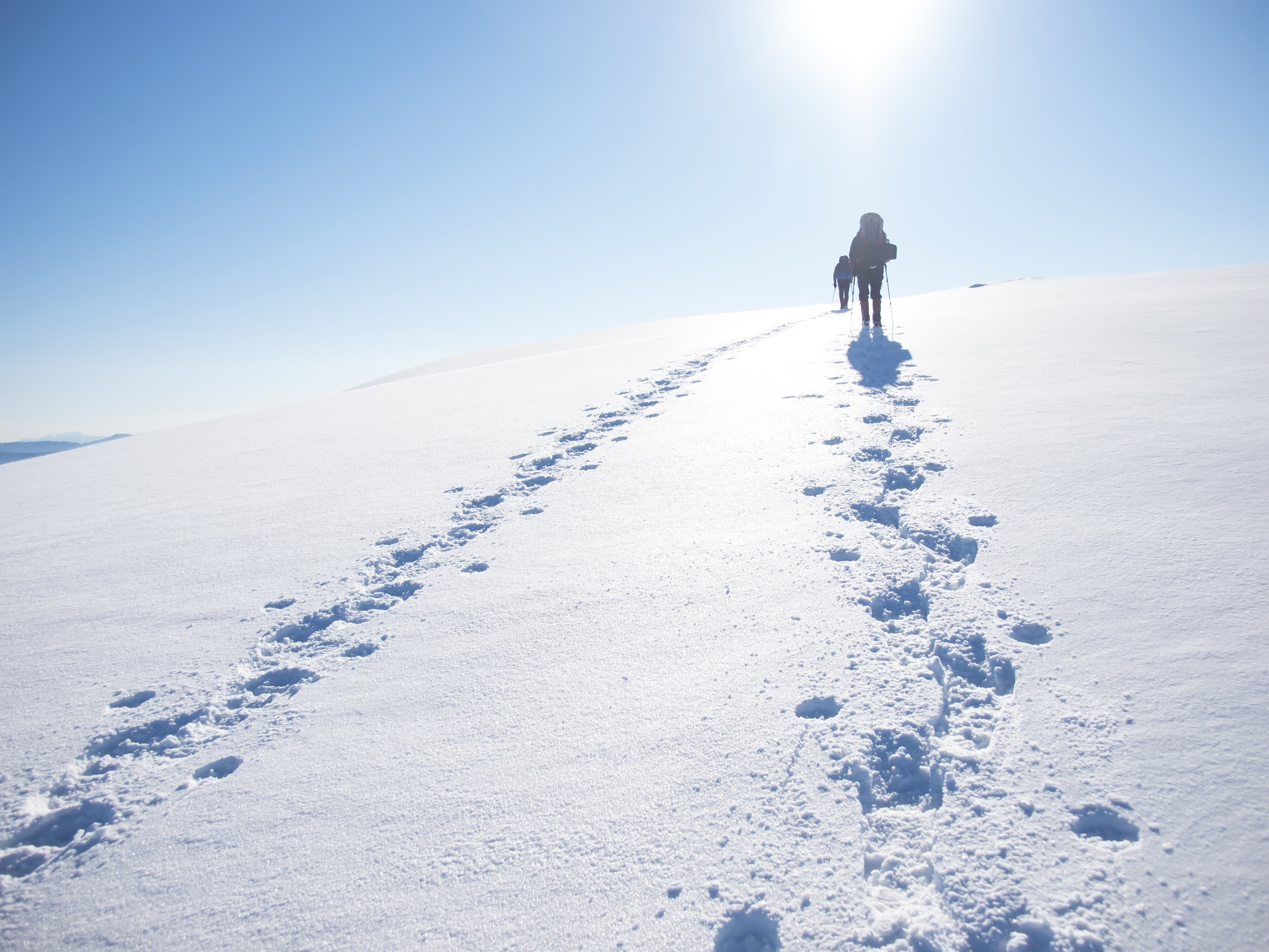 Man walking up a ski slope | Photo: Shutterstock