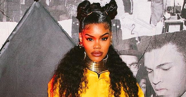 Teyana Taylor Flaunts Her Growing Baby Bump in Yellow Overalls at Her Star-Studded Album Listening Party