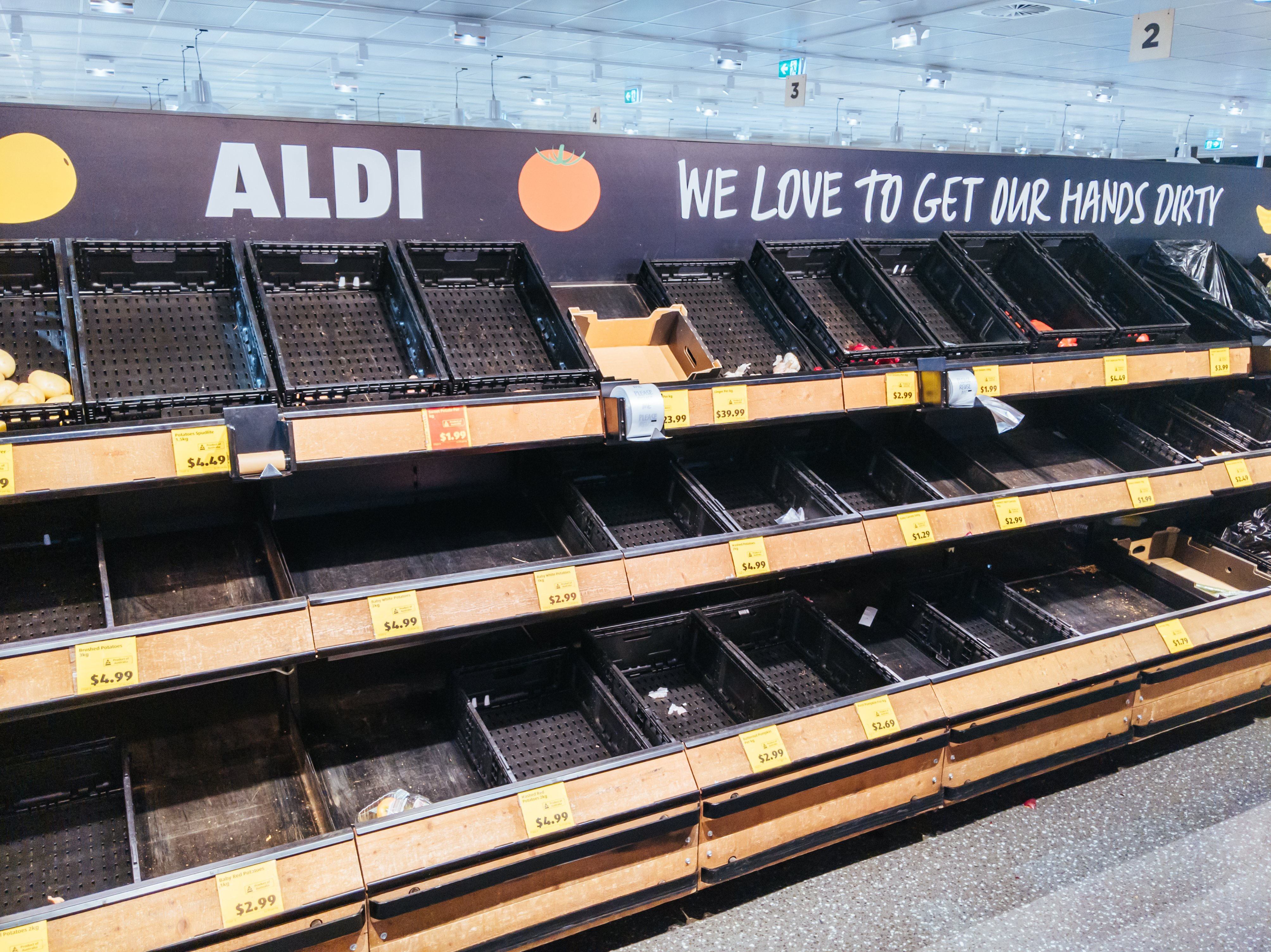 Empty shelves became a view across many Aldi Supermarkets throughout the pandemic. | Photo: Getty Images.