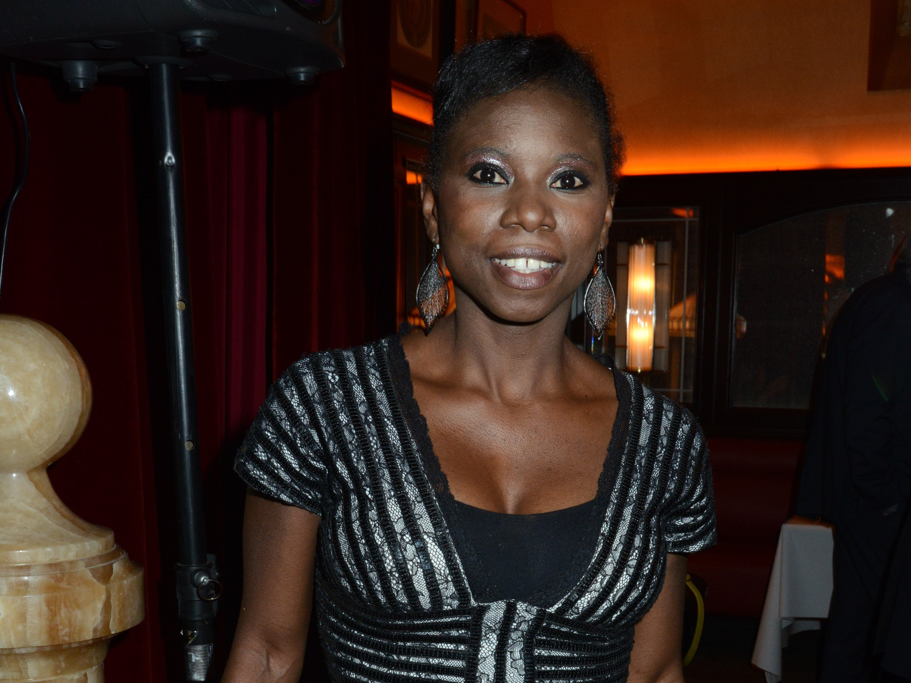 Ice skater Champion Surya Bonaly attends the 'Bistro Chic Napoleone' Champs Elysees Opening Cocktail on November 6, 2013 | Photo: Getty Images