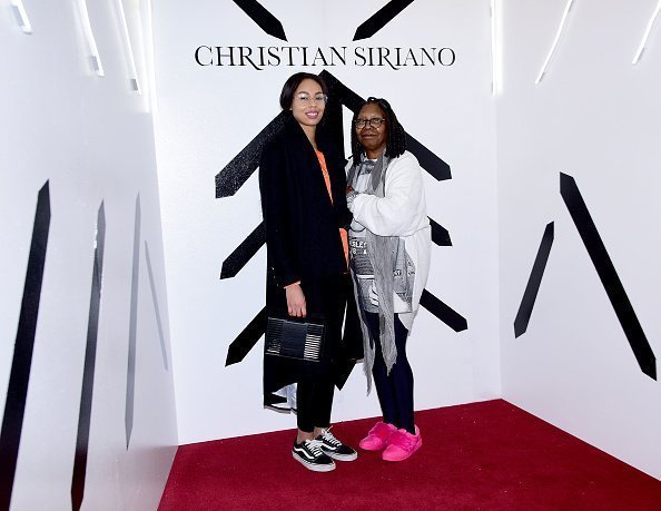 Jerzey Dean and Whoopi Goldberg pose backstage at the Christian Siriano show at The Grand Lodge on February 10, 2018 in New York City | Photo: Getty Images