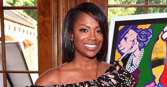 'The Masked Singer' Winner Kandi Burruss Shows Legs & Cleavage in a Blue Dress with High Slits