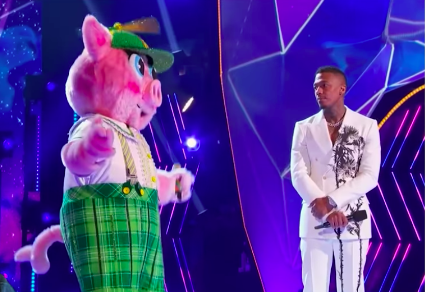 """Screenshot of the Piglet and Nick Canon on the """"Masked Singer.""""   YouTube: The Ringer"""