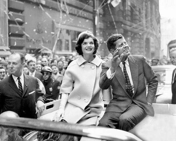 Presidential candidate John F. Kennedy rides on a car with wife Jackie in a ticker tape parade at the Wall Street area of Manhattan on October 19, 1960   Source: Getty Images