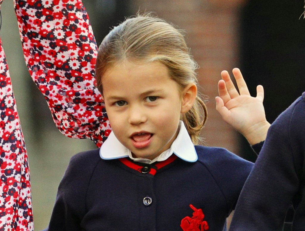 Princess Charlotte waves upon arrival for her first day of school at Thomas' Battersea in London on September 5, 2019 | Photo: Getty Images