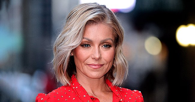 Kelly Ripa Shares Throwback Pic of Husband Mark Consuelos in Hawaii Carrying Their Two Eldest Kids