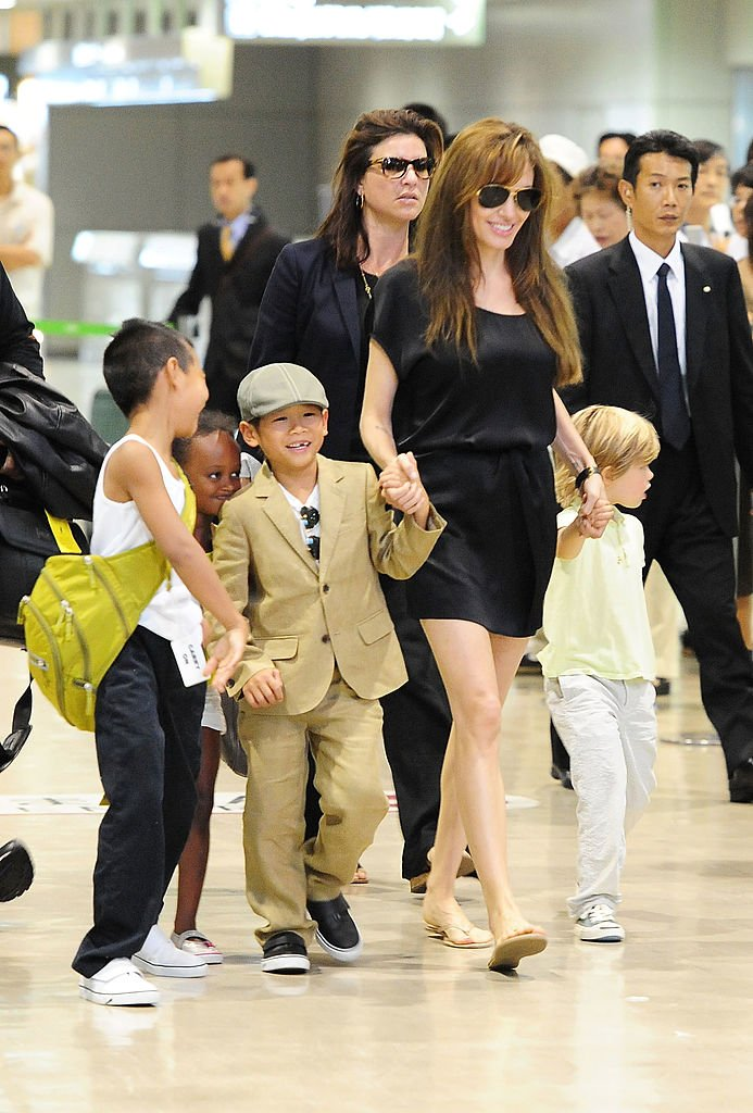 Angelina Jolie with her children Maddox, Pax, Zahara, Shiloh on July 26, 2010 in Narita, Japan | Photo: Getty Images