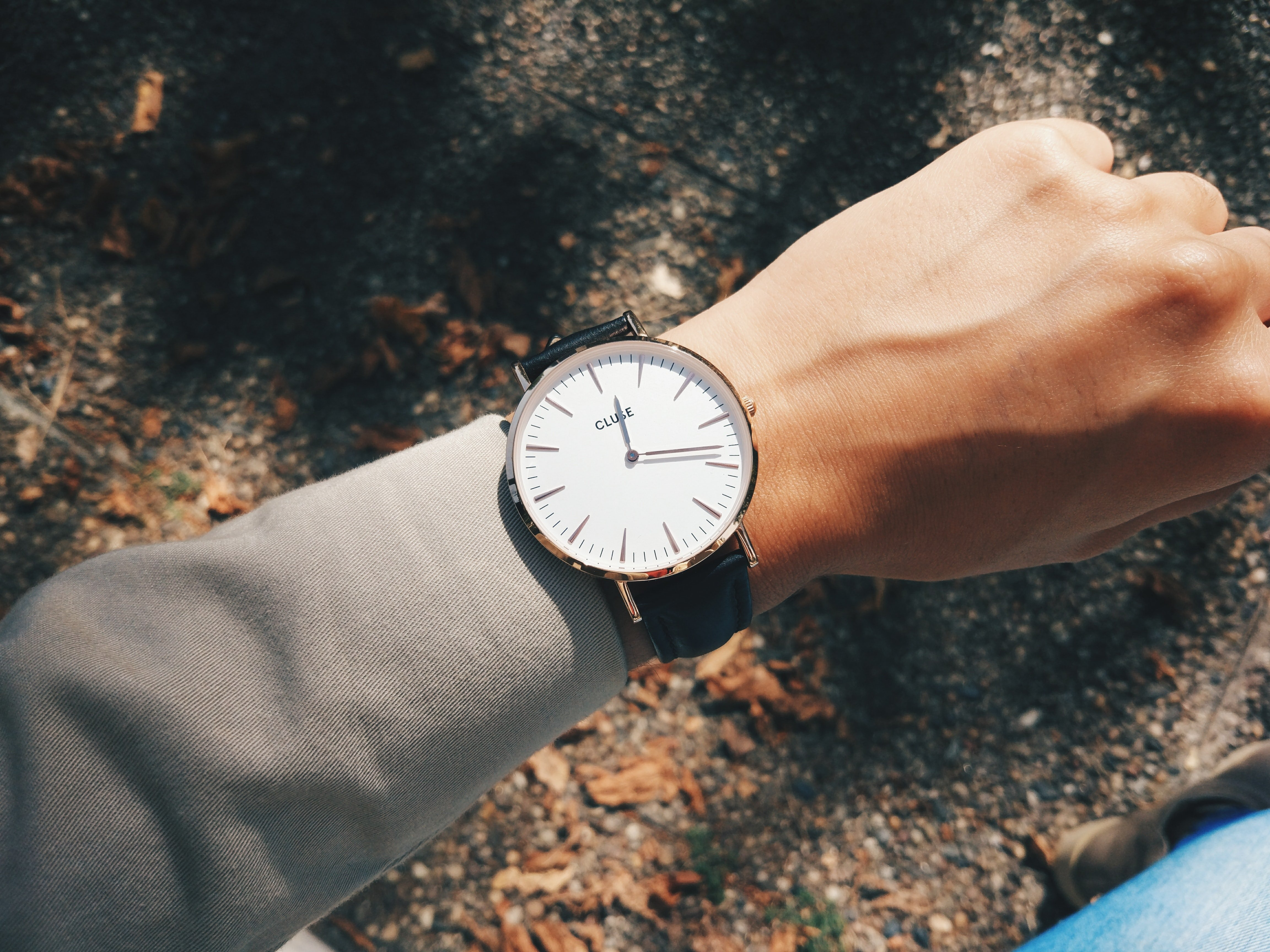 A close-up of a watch strapped to the wrist. | Photo: Unsplash