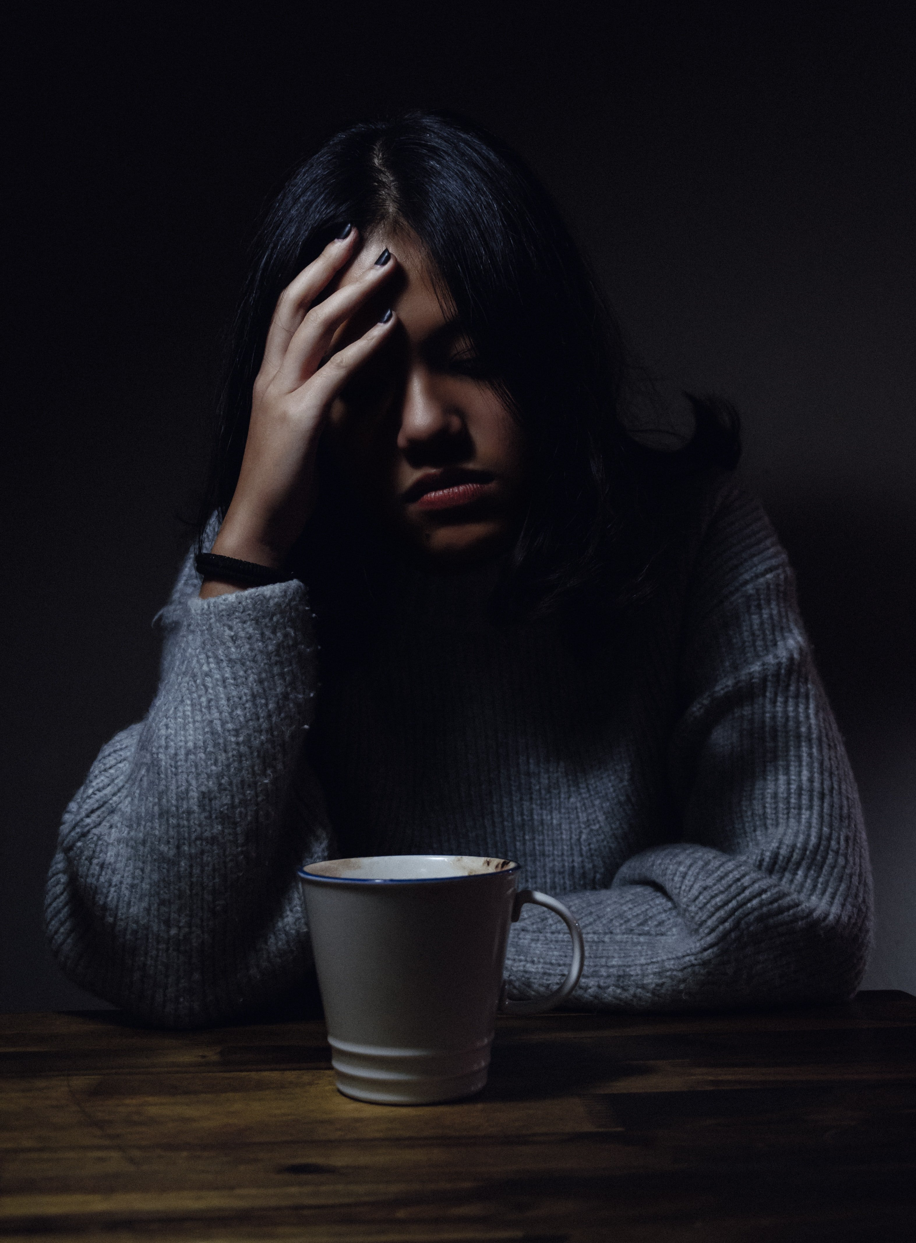 Picture of a sad woman wearing a gray jumper | Source: Unsplash /  Anh Nguyen