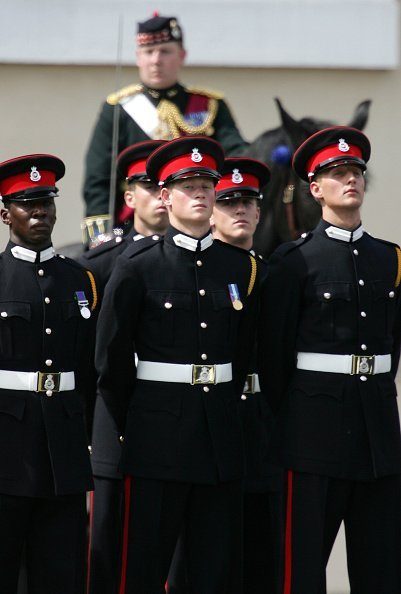 Prince Harry (C) takes part in the Trooping Of New Colours alongside his fellow officer cadets at the Royal Military Academy on June 21, 2005, in Sandhurst, England. | Source: Getty Images.