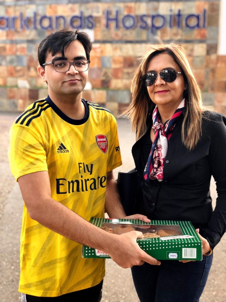 Mariam with her handsome eldest son, Nasser Khan, delivering donuts to Parklands Hospital Radiotherapy Department in August 2019.   Source: Dr. Mariam Seedat Khan