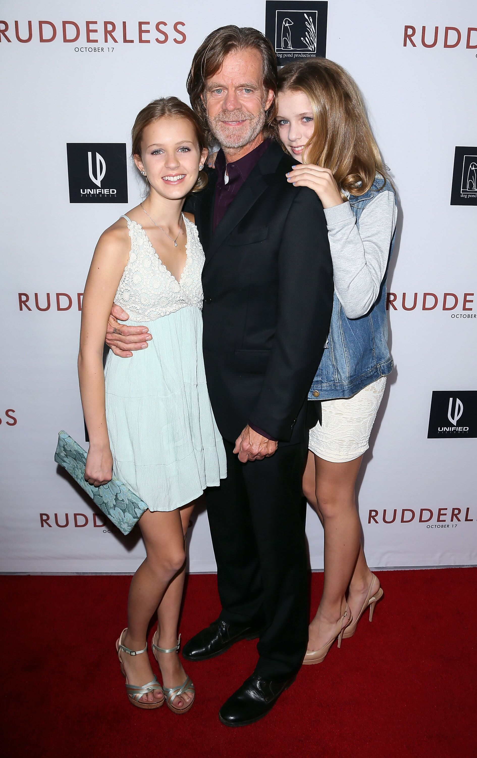 William H. Macy and his daughters at a screening of Rudderless on October 7, 2014, in Los Angeles, California | Photo: David Livingston/Getty Images