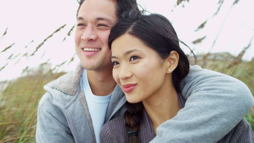 Young couple smiling in each other's arms   Shutterstock