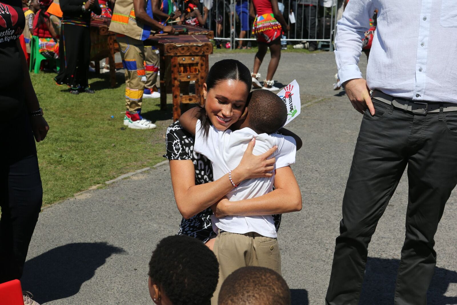 Meghan Markle hugging a child that welcomed her to South Africa | Source: Getty Images/GlobalImagesUkraine