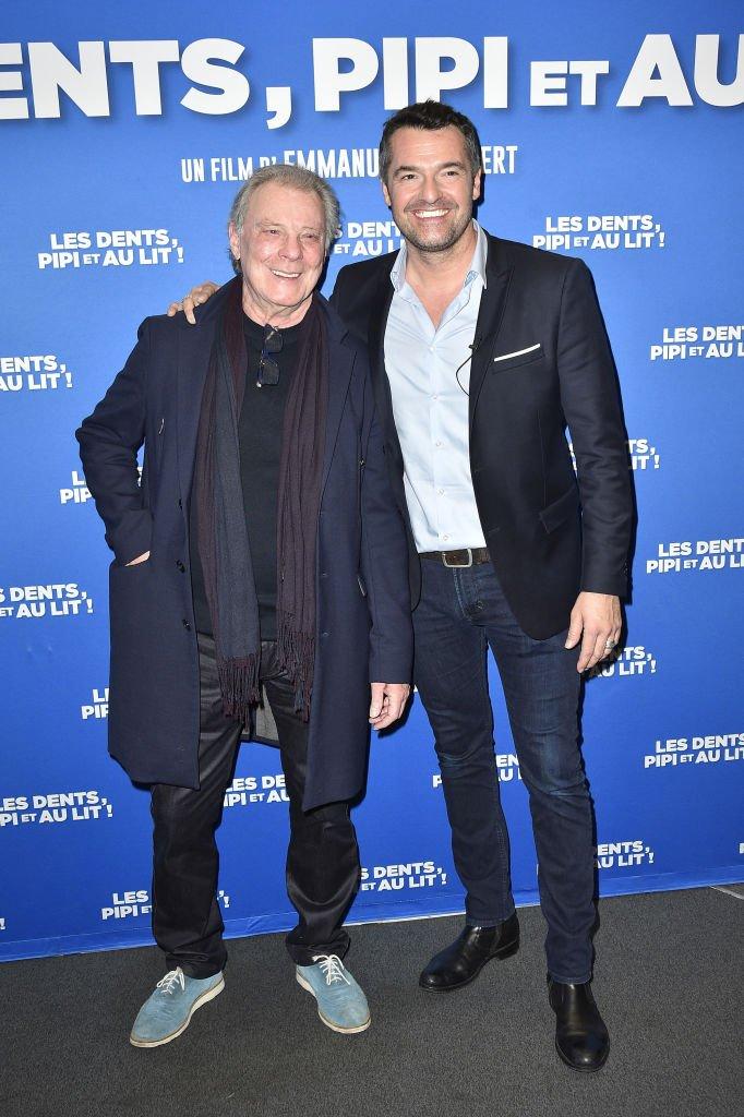 Herbert Léonard aux côtés de l'acteur Arnaud Ducret. l Source : Getty Images