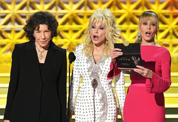 Lily Tomlin, Dolly Parton and Jane Fonda speak onstage during the 69th Annual Primetime Emmy Awards at Microsoft Theater on September 17, 2017, in Los Angeles, California.   Source: Getty Images.