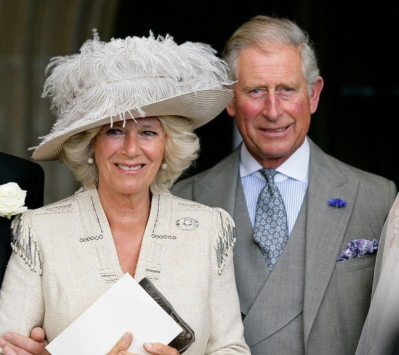 Camilla Parker-Bowles and Prince Charles at Ben Elliot and Mary-Clare Winwood's wedding in Cheltenham, England in September 2011. | Image: Getty Images.