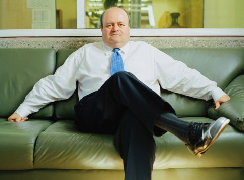 Photo of a businessman sitting on leather sofa | Photo: Getty Images