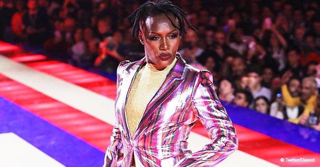 Grace Jones, 70, Flaunts Fit Figure in Gold Bodysuit & Rainbow Jacket on Paris Fashion Week Runway