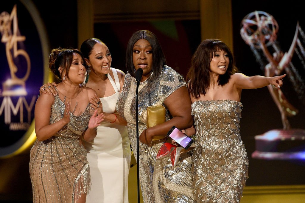"""Adrienne Bailon, Tamera Mowry, Loni Love and Jeannie Mai, winners of Outstanding Entertainment Talk Show Host for """"The Real,"""" accept award onstage during the 45th annual Daytime Emmy Awards 