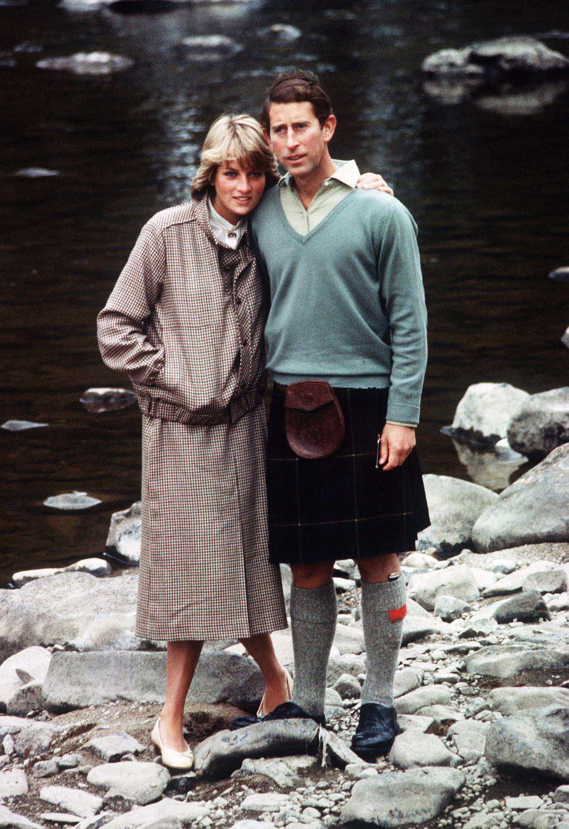 Prince Charles and Princess Diana pose for a photo on the banks of the river Dee in the grounds of Balmoral Castle during their honeymoon on August 19, 1981, in Balmoral, Scotland. | Source: Getty Images.