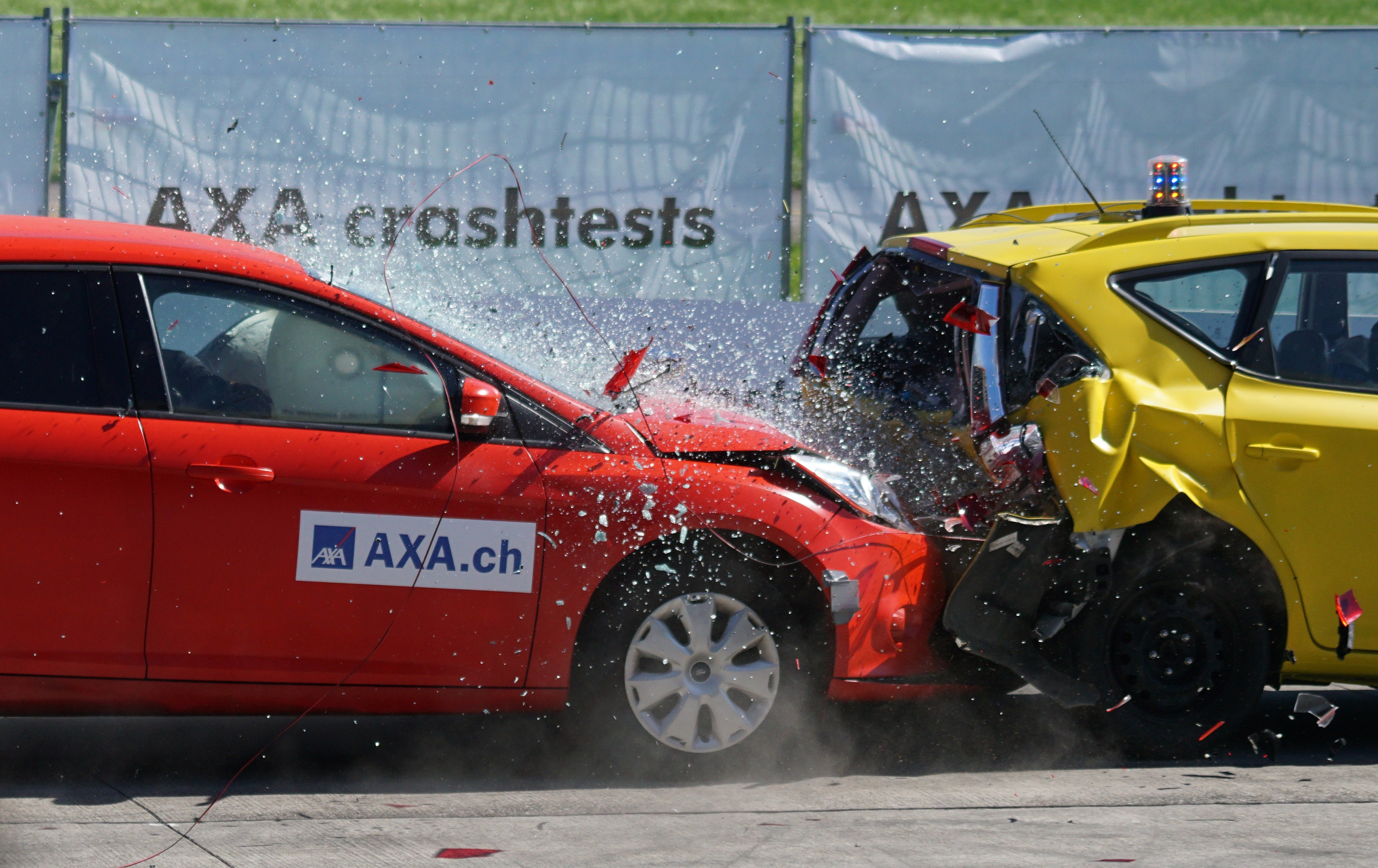 Pictured - A red and yellow hatchback Axa crash tests   Source: Pexels