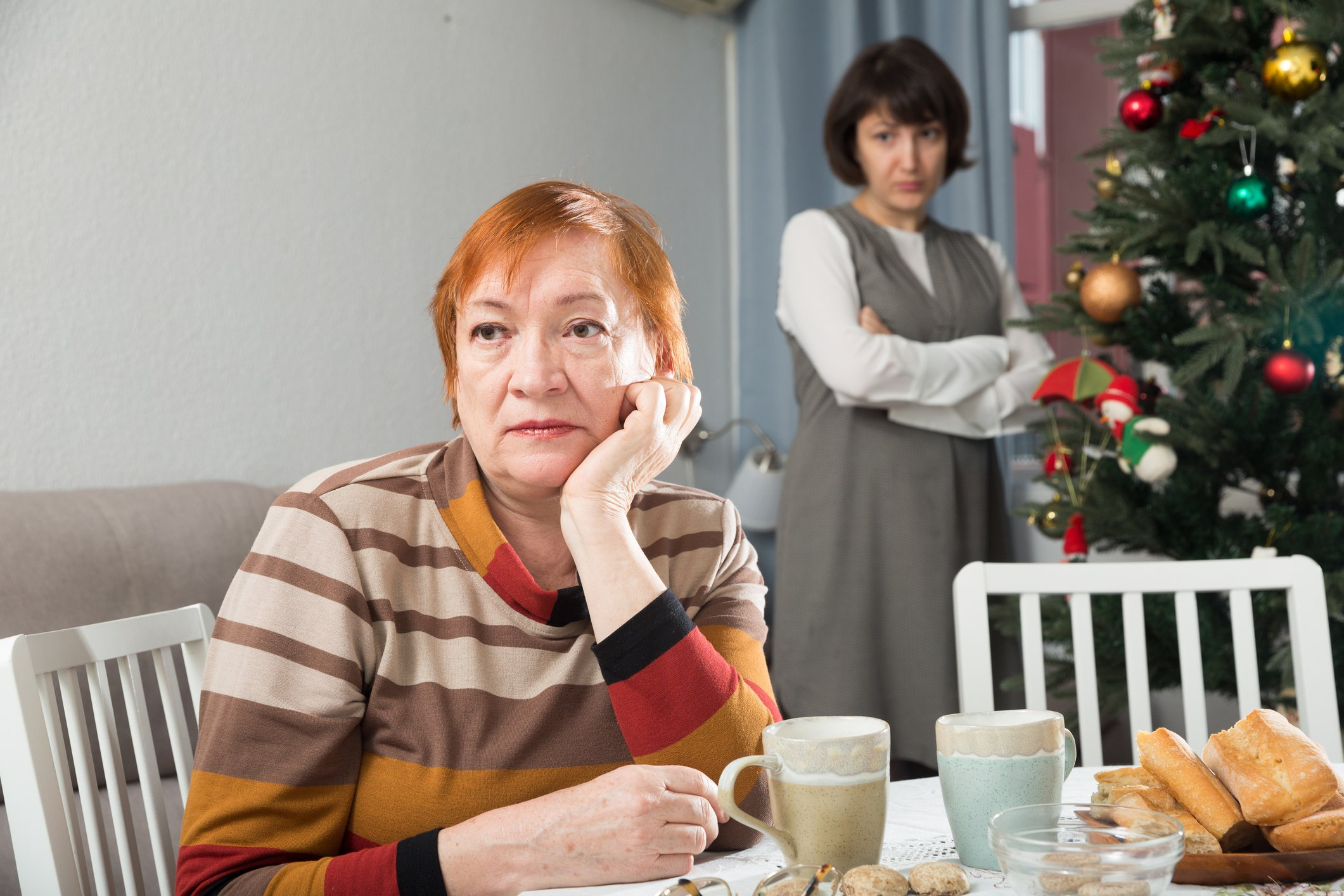 Photo of an upset mother and daughter at the Christmas table | Photo: Getty Images