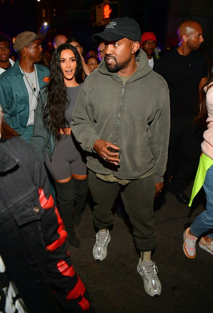 Kim Kardashian and her husband Kanye West wearing his Yeezys at an album release party in June 2018. | Photo: Getty Images