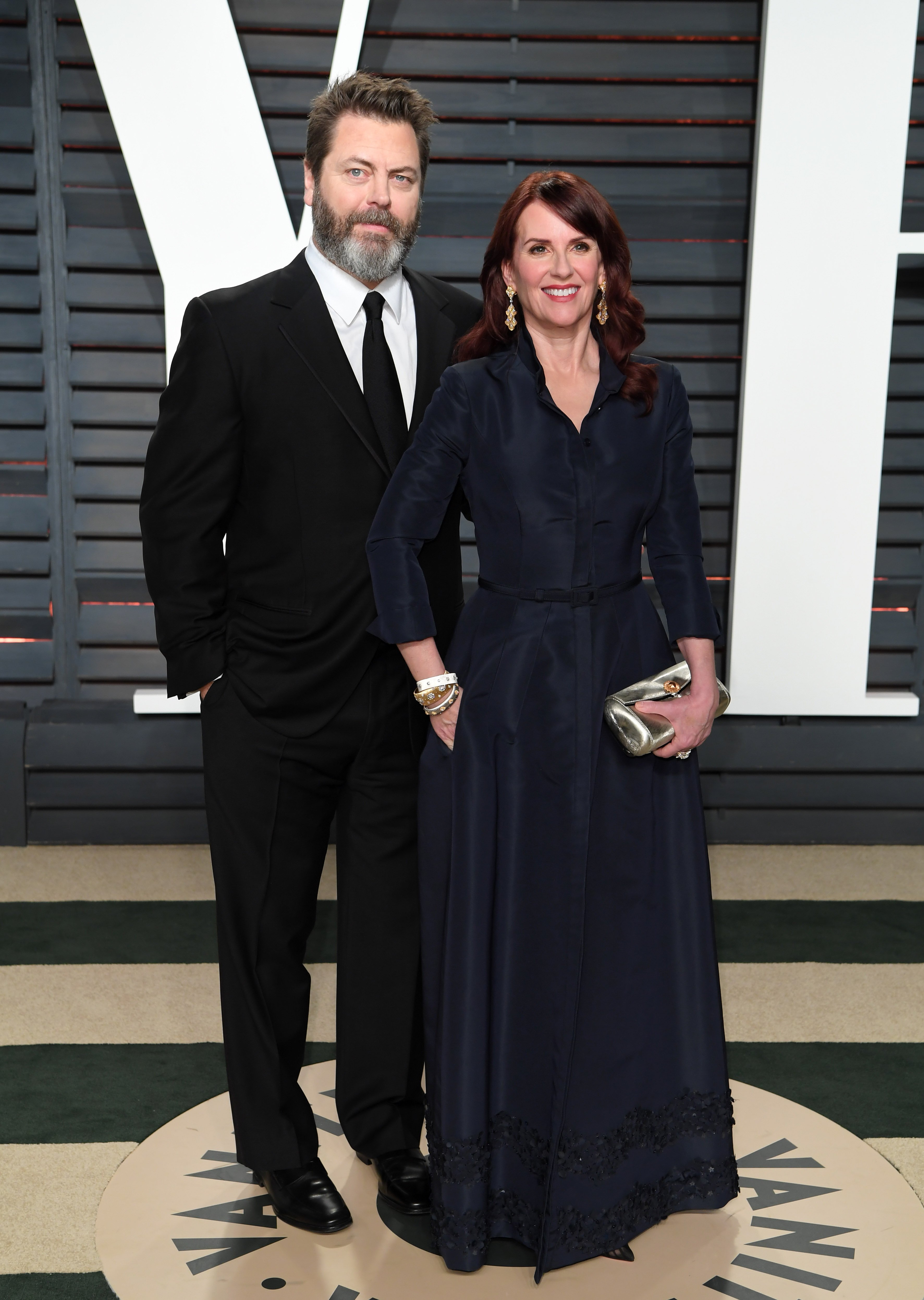 Nick Offerman and Megan Mullally arrive for the Vanity Fair Oscar Party hosted by Graydon Carter at the Wallis Annenberg Center for the Performing Arts on February 26, 2017, in Beverly Hills, California. | Source: Getty Images.