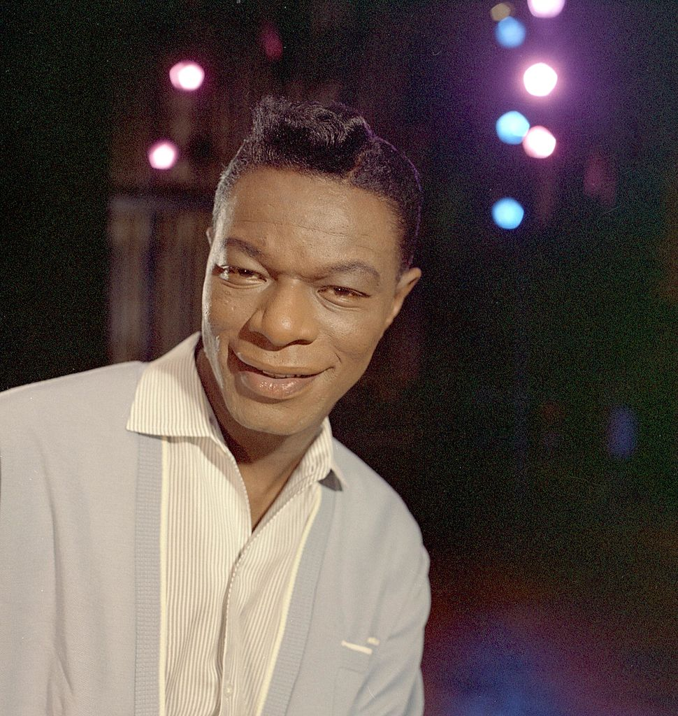 """Singer Nat """"King"""" Cole records during a session in the Capitol Recording Studios in circa 1964   Photo: Getty Images"""